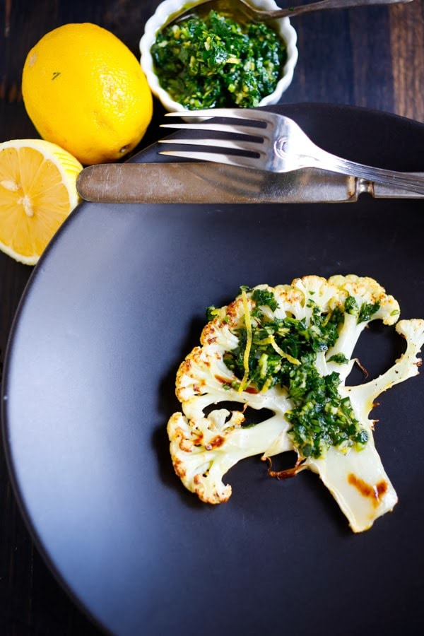 Roasted Cauliflower Steaks with Gremolata, a healthy delicious vegan side dish you that is simple and easy, and full of flavor! www.feastingathome.com #cauliflower #veganside #vegan #sidedish #healthy #cauliflowersteaks