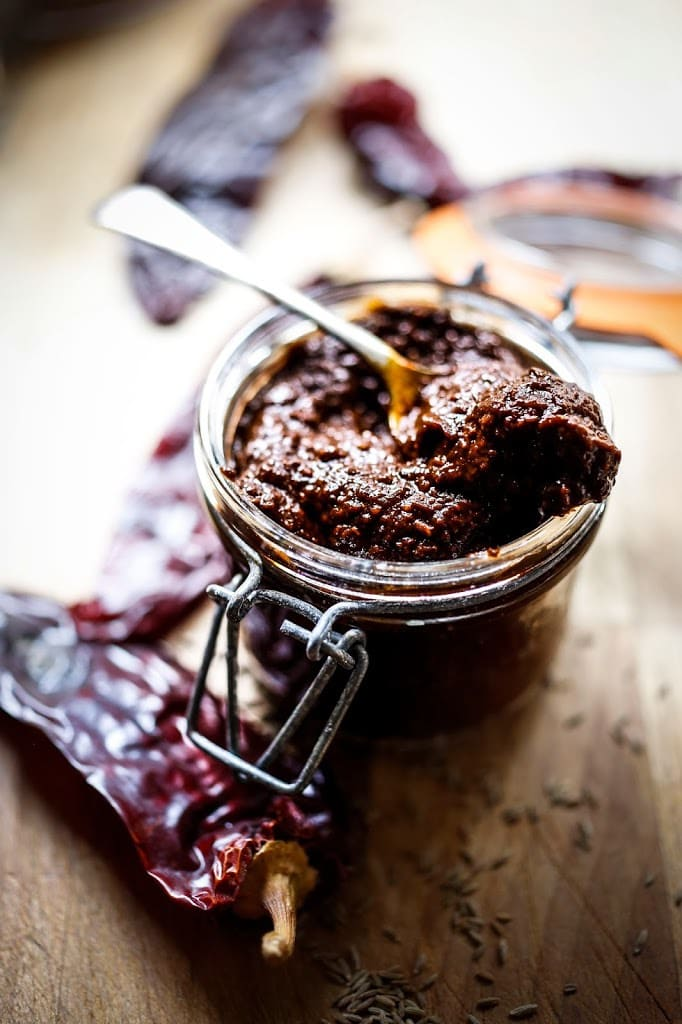 Authentic Harissa Paste Recipe- a north African condiment that will add depth and smokey spice to meats, stews and roasted vegetable dishes. | www.feastingathome.com