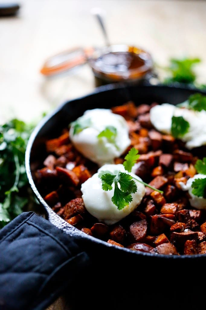 Sweet potato hash with Harissa, poached eggs and mergeuz sausage | www.feastingathome.com