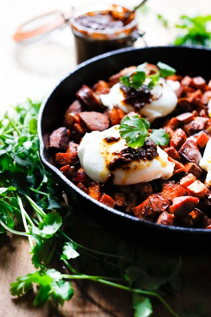 Sweet Potato Hash with Poached Eggs and Harissa Paste - a delicious, North-African inspired, one-skillet breakfast that is bursting with flavor!   Gluten Free #sweetpotato #sweetpotatohash #harissa #harissapaste #harissasauce #eggs #morocan