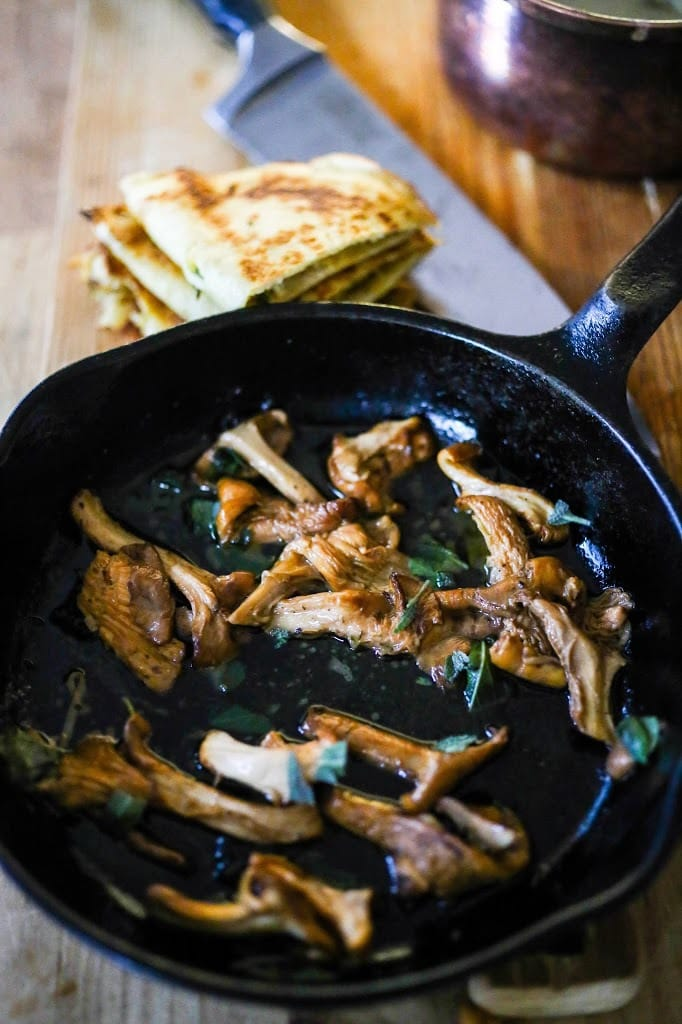 Savory Mushroom Crepes with Spaghetti Squash and Sage drizzled with Bechemal Sauce - a hearty cozy vegetarian dinner recipe, perfect for the colder months! #crepes #savorycrepes #mushroomcrepes #mushroomcrepes www.feastingathome.com