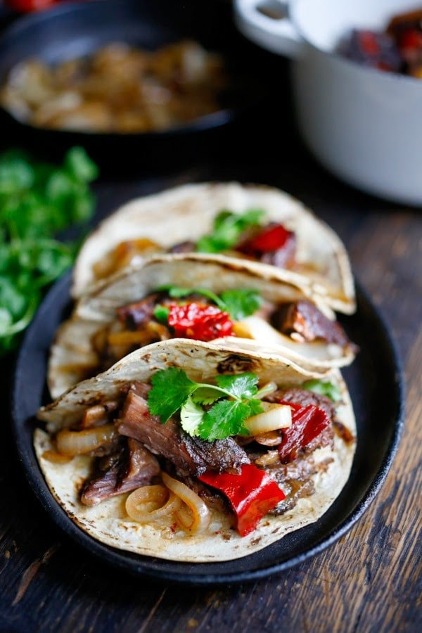 Tender, falling off the bone braised beef are the star of these Mexican short rib tacos, cooked low and slow in the oven with dried Mexican chilies, beef stock and stout.    www.feastingathome.com