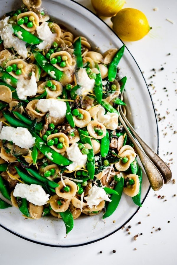 Spring Orecchiette Pasta with asparagus, mushrooms, peas and fresh herbs in a light carbonara sauce with dollops of creamy Burrata cheese. | #orecchiette #burrata #springpasta