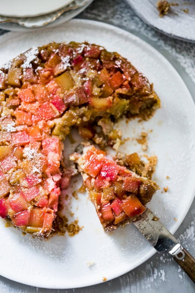Upside Down Rhubarb Cake that is gluten free- made with Almond Flour. Deliciously addictive, perfect for Spring. | www.feastingathome.com #rhubarb #rhubardcake #upsidedowncake #rhubarbtart #glutenfreecake