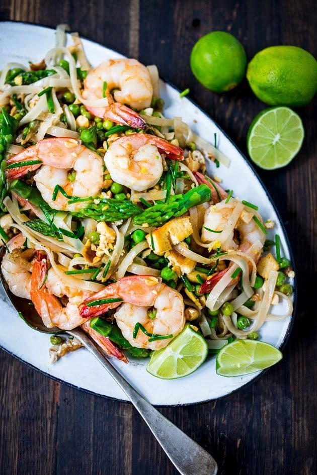 An authentic recipe for Pad Thai made with spring veggies and authentic Thai ingredients, adapted from the Pok Pok Cookbook. #padthai #pokpok #shrimppadthai