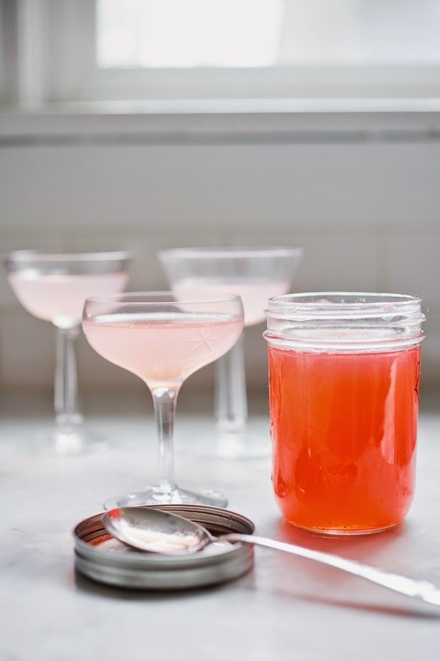 A simple delicious recipe for Rhubarb Shrub that can be used to make cocktails and mocktails. A great way to preserve the rhubarb growing in your garden! #shrub #rhubarb #rhubarbrecipes #mocktail | Feasting at Home