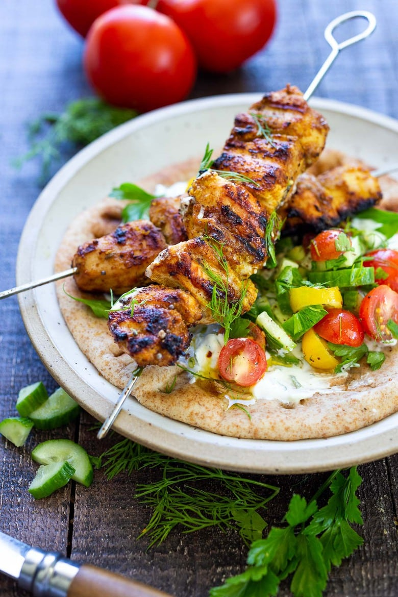 This EASY Grilled Chicken Shawarma recipe is bursting with Middle Eastern Flavors! Serve it as a wrap, in pita bread with tzatziki sauce and Israeli Salad. | #shawarma #chicken #chickenshawarma #shawarmawrap