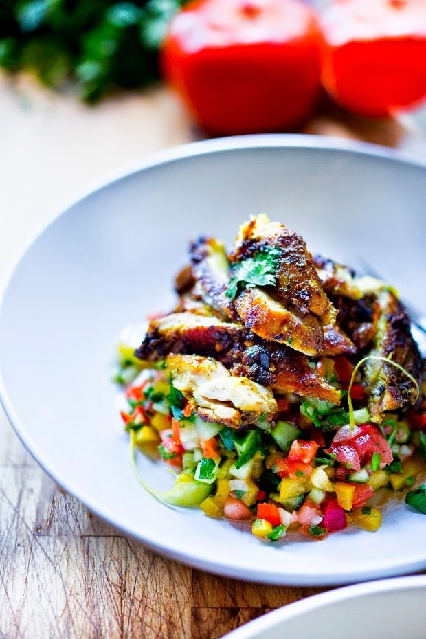 Israeli Salad REcipe made with finely chopped vegetables, fresh herbs, lemon and olive oil. Vegan and Gluten Free!   www.feastingathome.com #israelisalad #vegan #vegansalad #veggies #lunch #middleeastern #healthysalad