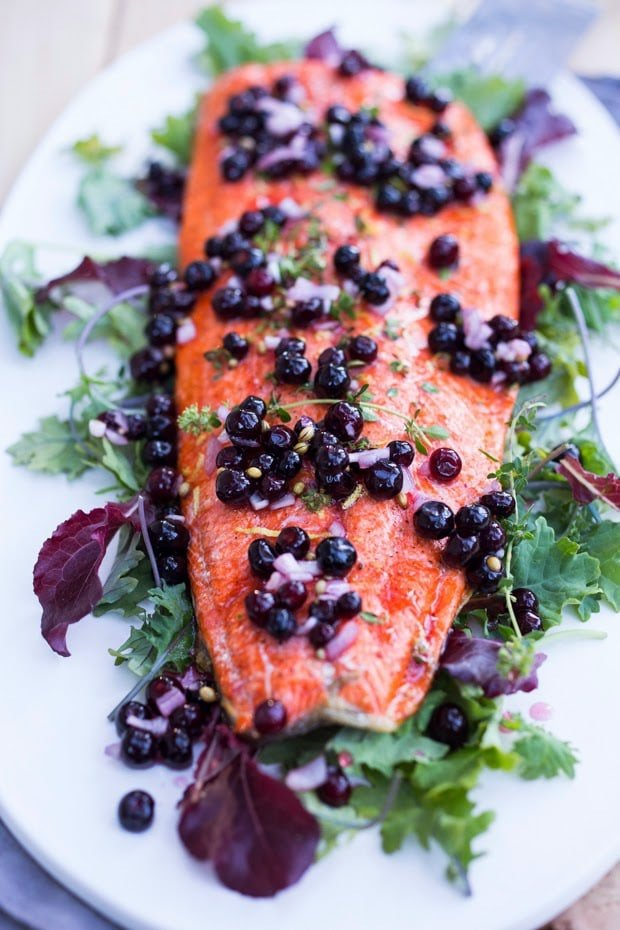 Pickled Huckleberries make this Grilled Huckleberry Salmon recipe a winner. Served atop Grilled salmon, this is a true Northwest inspired summer meal. Gluten free, healthy! | www.feastingathome.com