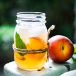 Simple Refreshing Peach Sangria Recipe ...a delicious summer drink made with white wine and Elder flower liquor (or syrup) that can be made ahead. Perfect for a crowd!