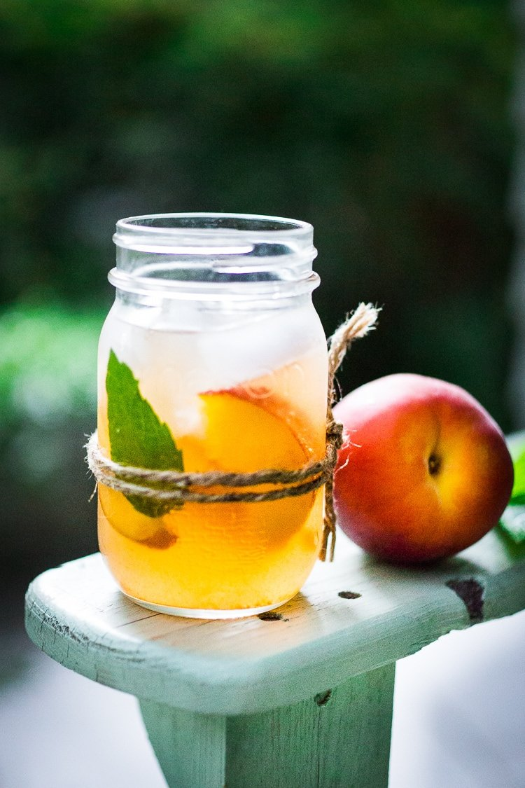 Simple Refreshing Peach Sangria ...a delicious summer drink made with white wine and Elder flower liquor (or syrup) that can be made ahead. Perfect for a crowd!  #peachsangria #peach #sangria | www.feastingathome.com