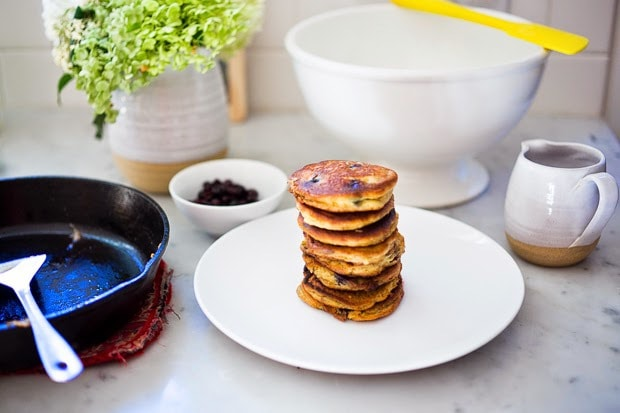 EASY Almond Flour Pancakes with fresh huckleberries (or sub your favorite summer berry) - a delicious, low-carb, gluten-free, paleo recipe for our favorite breakfast! #pancakes #almondflour #paleopanckes #huckleberries