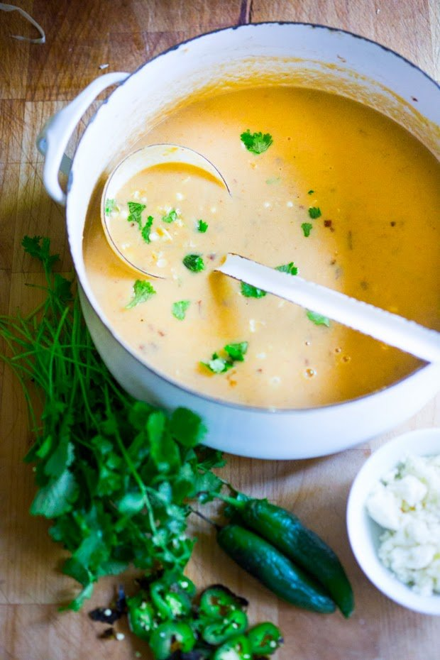 Sweet Corn Soup with Charred Jalapeño, fresh cilantro and queso fresco cheese. Simple and delicious! | www.feastingathome.com