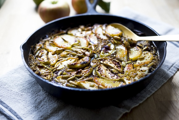 Baked Oats with Apples, Maple, Pumpkin Seeds and the warming spices of cinnamon and cardamom. Vegan, GF.
