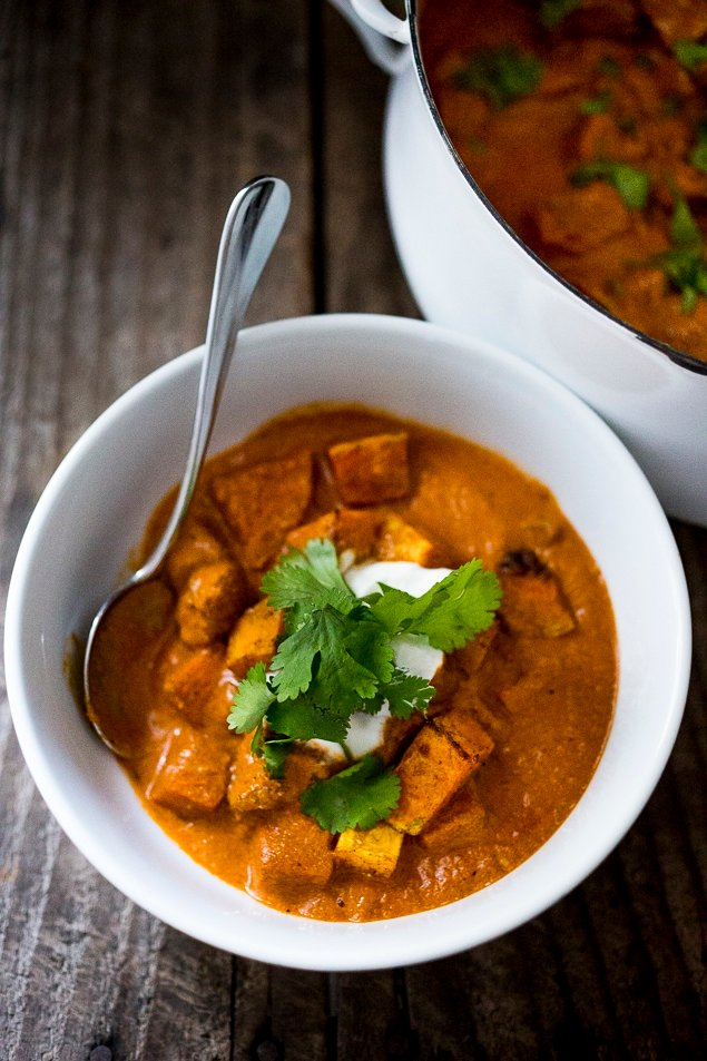 This fall-inspired recipe for Roasted Butternut Tikka Masala can be made with chickpeas or chicken. The fragrant tomato coconut sauce is infused with Indian spices. Vegan & Gluten Free! A healthy delicious dinner recipe, perfect for fall! #tikkamasala #butternuttikkamasala #butternutmasala #vegandinner #vegetariandinner #falldinner