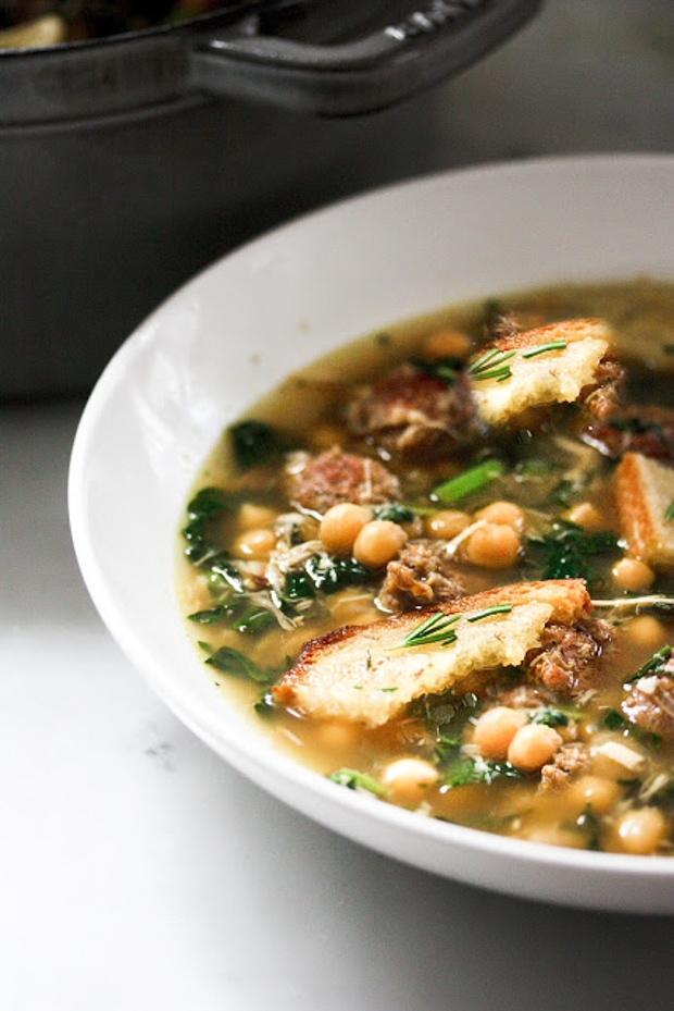Chicken, kale and Chick pea soup with Rosemary Croutons + 10 cozy, Rut-Busting Fall recipes to help inspire us to break us out of the habit of making the same old things this fall! | www.feastingathome.com