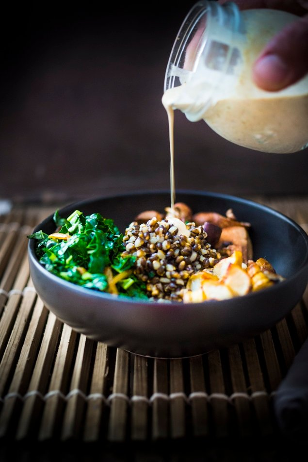 This Roasted Sunchoke and Black Nile Barley Bowl, with kale, mushrooms and parsnips & a Zaatar spiced Tahini Sauce is perfect for fall! Vegan and Nutritious!