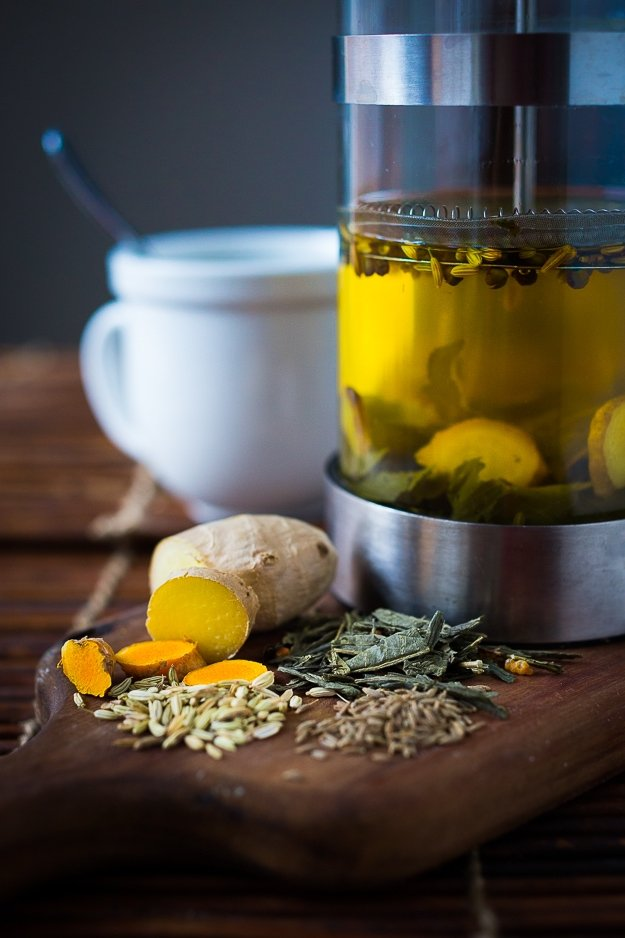 Ayurvedic Turmeric Detox Tea...a special blend of turmeric, ginger and whole spices...to help detox the body! Plus The incredible healing power of TURMERIC ROOT ! Learn all the ways it helps our bodies + Plus 10 delicious turmeric Recipes to harness its super power! #turmeric #turmericrecipes #turmericroot