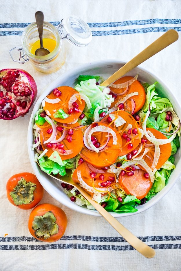 Butter Lettuce Salad with persimmons, shaved fennel, pomegranate seeds, and a bright citrus dressing. Perfect for the holiday Table! Vegan and Gluten-free | #persimmon #feastingathome #butterlettucesalad #vegansalad #salad #holidaysalad #persimmonsalad #persimmonrecipe #christmasrecipes