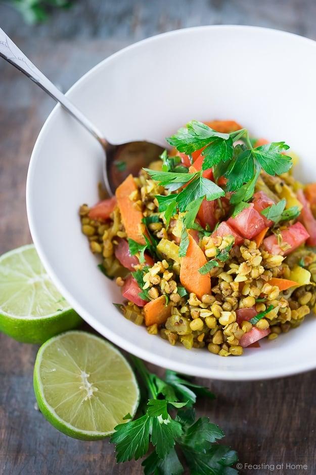 "A healing bowl of khichdi, an Ayurvedic recipe considered to be India's ""comfort food"" made w/ healing ingredients, detoxing veggies & soothing turmeric. Vegan and GF   www.feastingathome.com #khichuri #khichdi #khichidi #ayurvedic #ayervedicrecipes #khichadi #vegan #mungbeans #buckwheat"