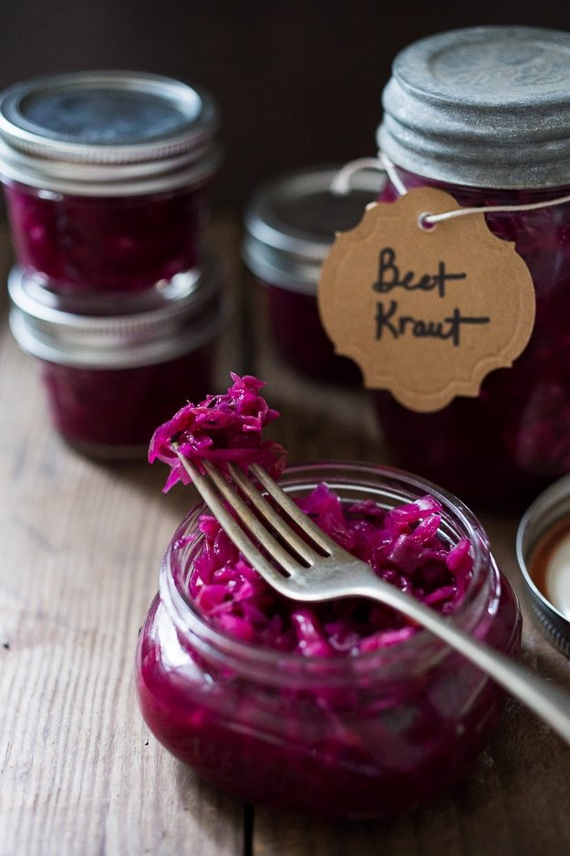 A simple easy, small batch recipe for Beet and Cabbage Sauerkraut that anyone can make using a mason jar, that takes only 20 minutes of hands-on time. Full of good healthy good bacteria that will energize the body and help heal the gut. #beetkraut #fermentedbeets #fermented #sauerkraut