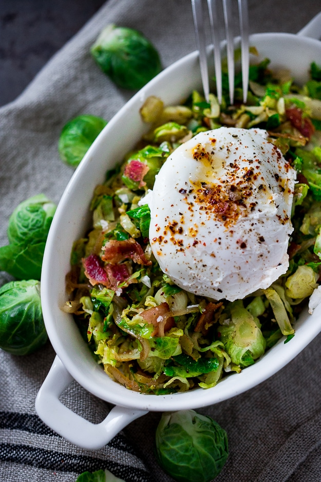 Soft Poached Eggs with Brussel Sprout Hash, Aleppo chili flakes and optional bacon crumbles - a simple easy brunch recipe perfect for Mother's day. #brusselsprouts #eggs #mothersday