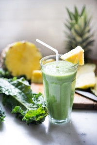 Matcha Green Tea & Pineapple Smoothie with Kale- an instant mood lifter and energizing drink full of healthy antioxidants!   www.feastingathome.com #matcha #smoothie #greensmoothie #matcharecipes #smoothies #vegan #plantbased #eatclean #detox #cleaneating