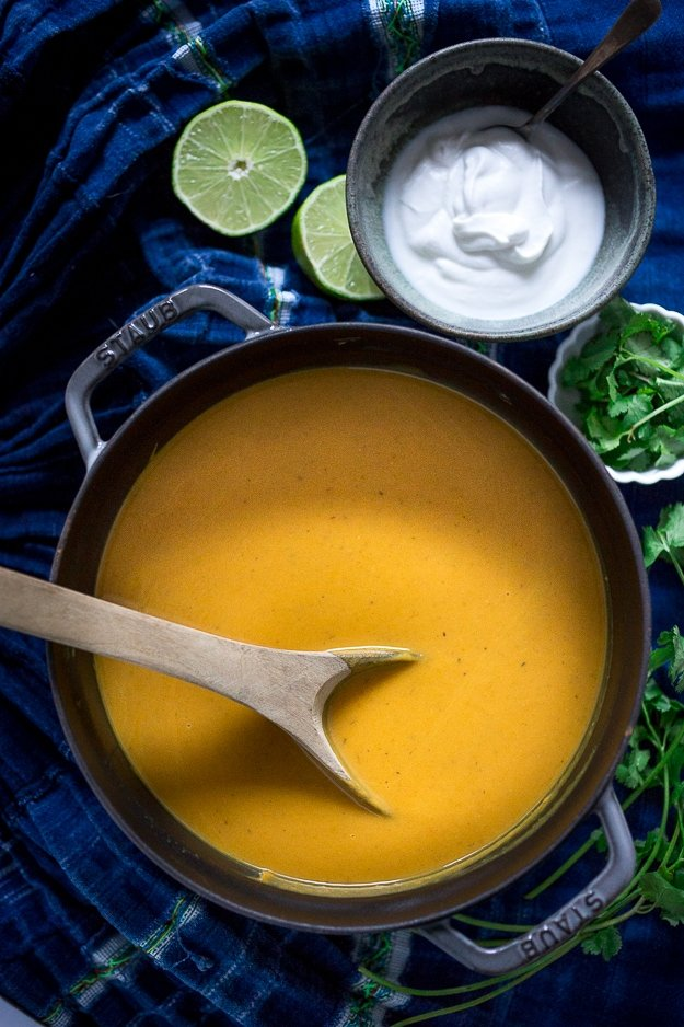 Thai Sweet Potato Soup with coconut, lemongrass and ginger....a light and healthy recipe that is Vegan and Gluten free! | www.feastingathome.com #sweetpotatosoup #thaisoup #sweetpotatorecipe