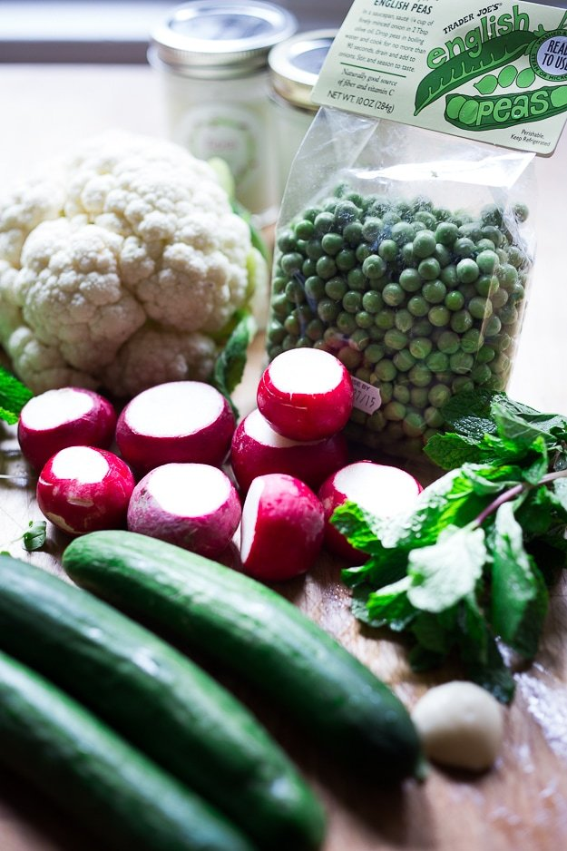 Shaved Cauliflower and Spring Pea Salad w/ Yogurt and Mint | www.feastingathome.com