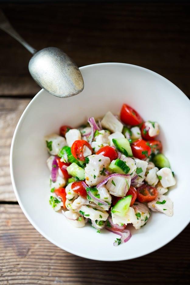 Easy Ceviche Recipe ...with fresh fish, chili, lime, cilantro, avocado, tomato and cucumber...a simple healthy appetizer perfect for Cinco de Mayo | www.feastingathome.com
