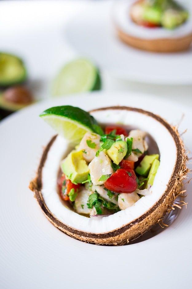 Easy Ceviche Recipe with chili, lime, avocado, cilantro, cucumber and tomato...perfect for Cinco de Mayo! | www.feastingathome.com