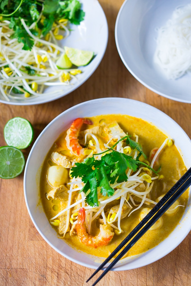 Laksa Soup w/ Coconut Curry, Chicken and Shrimp over rice noodles| www.feastingathome.com