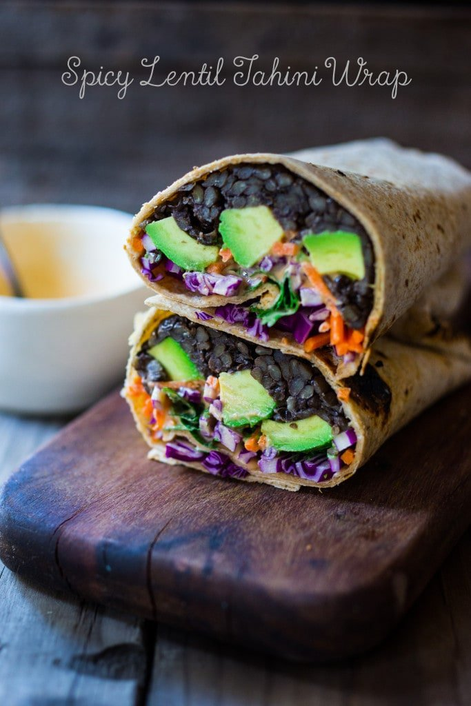 Spicy Lentil Tahini Wrap with avocado, carrots, cabbage and the tastiest Sriracha Tahini Sauce. Vegan and Delicious! #lentilwrap