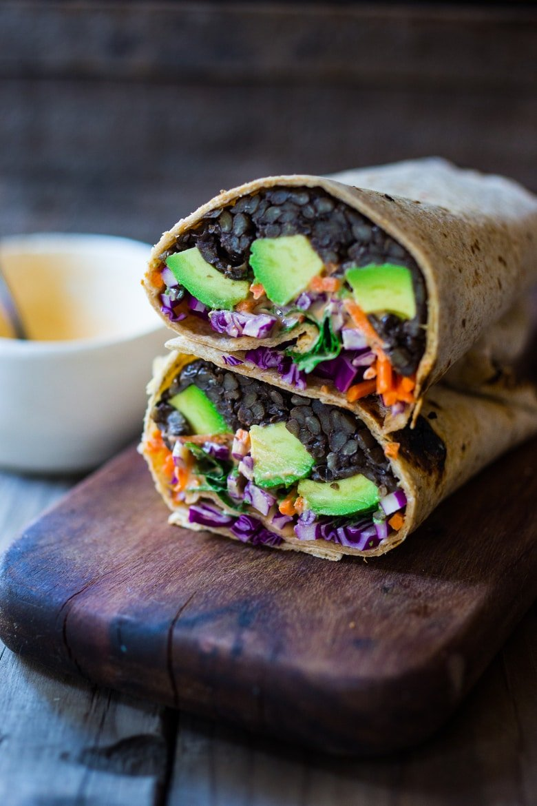 20 Delicious Healthy Lunches! |Spicy Lentil Wrap with Tahini Sauce - This easy vegan lentil wrap is full of crunchy raw veggies like carrots, beets, and cabbage with a spicy Sriracha Tahini sauce spooned over top. Simple, energiz