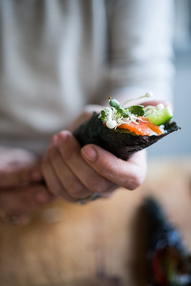 Smoked Salmon Hand Rolls filled with avocado, cucumber and smoked salmon with an easy step by step guide to making this Japanese-style sushi roll! | www.feastingathome.com #handrolls #sushi #salmon #smokedsalmon #salmonroll