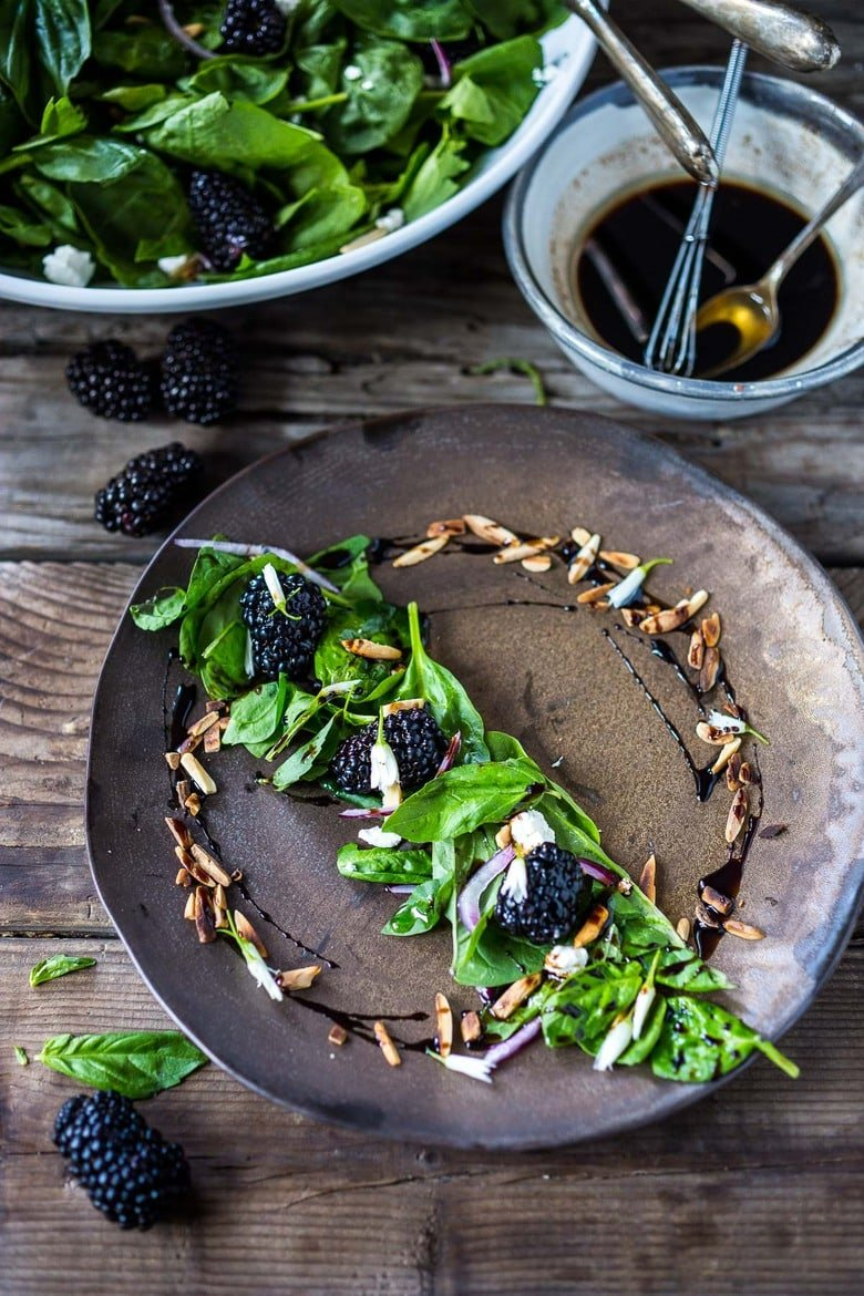 A simple recipe for Blackberry Salad with Basil and Arugula sprinkled with crumbled goat cheese, toasted almonds and a maple-balsamic dressing. A light and delicious summer salad! #blackberry #blackberrysalad