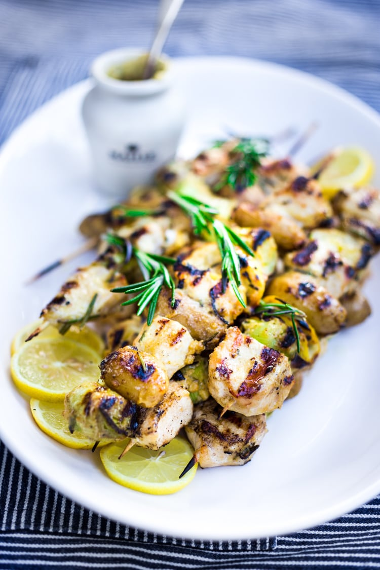 Grilled Dijon Chicken Skewers with leeks, potatoes and Rosemary. A delicious, healthy meal perfect for summer nights on the patio! #skewers #chickenskewers #dijonchicken #grilledchicken