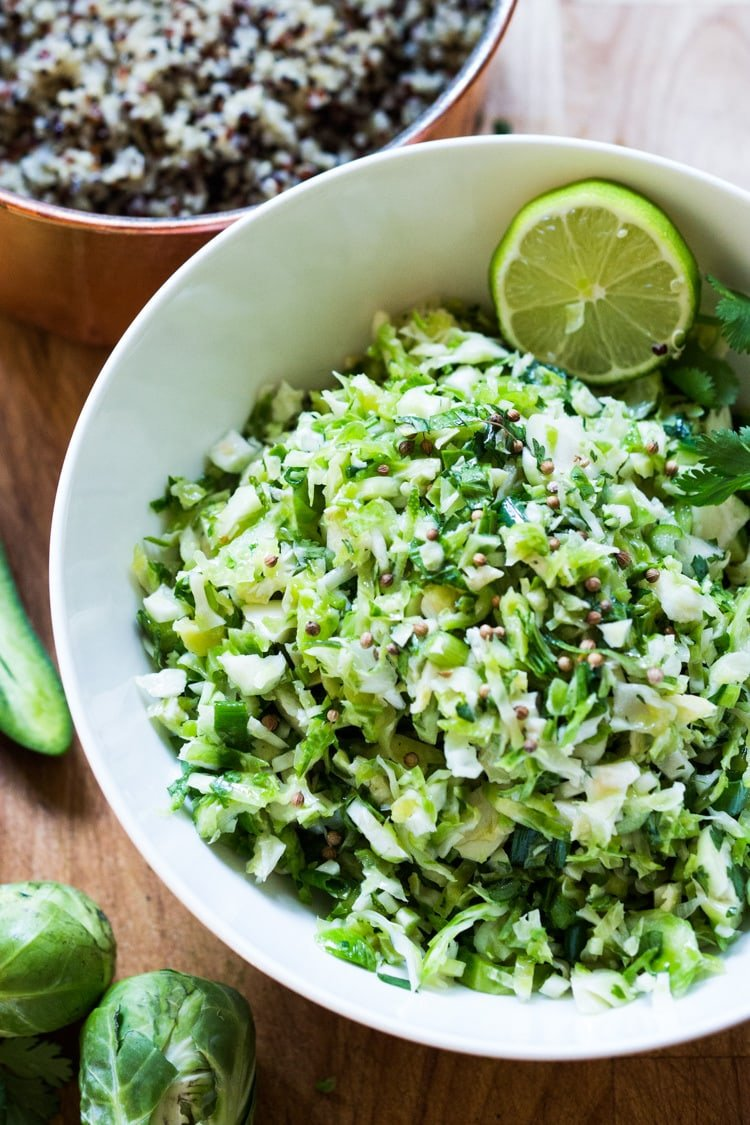 "Vegan Mexican Brussel Sprout Salad with jalapeño, lime and cilantro! Serve as a ""taco slaw"",  a side salad for grill mains or meats. This salad can be made ahead! #brusselsproutsalad #brusslesproutslaw #brusselsprouts #veganslaw #vegansalad #mexicanslaw"