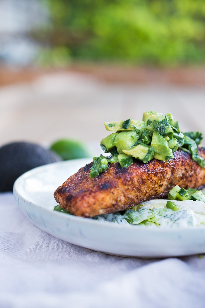 Mexican Grilled Salmon with Avocado Salsa   served over greens with creamy Cilantro Lime Dressing …can be made in 20 minutes. A delicious, healthy low-carb meal.