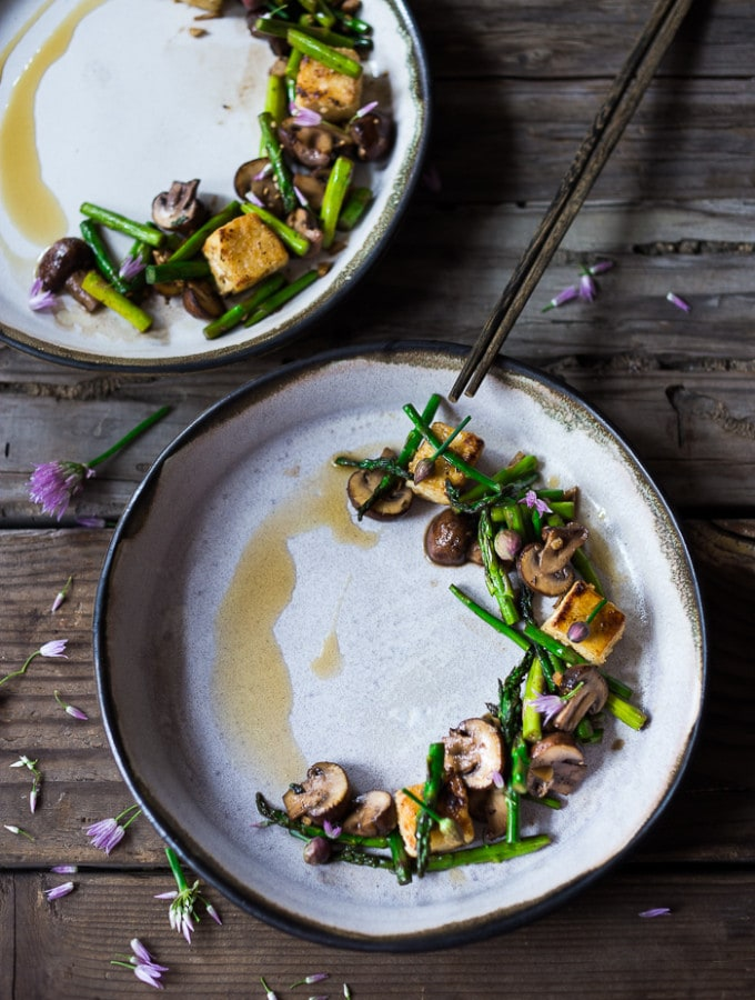 Wok seared asparagus and mushrooms with garlic, ginger and sesame...with crispy tofu- a vegan gluten free meal that can be made in 15 minutes flat! | www.feastingathome.com