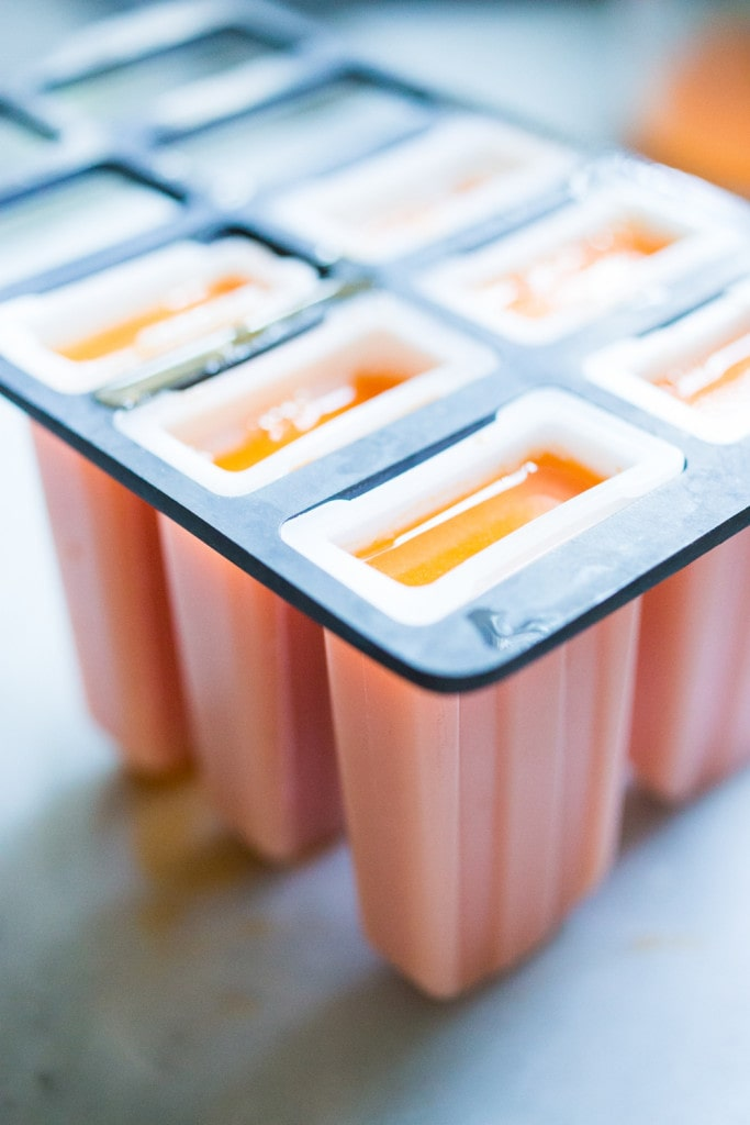 Healthy, delicious Grown-up Ice Pops with Orange, Carrot and Ginger and a hint of Turmeric, incredibly restorative and refreshing! | www.feastingathome.com