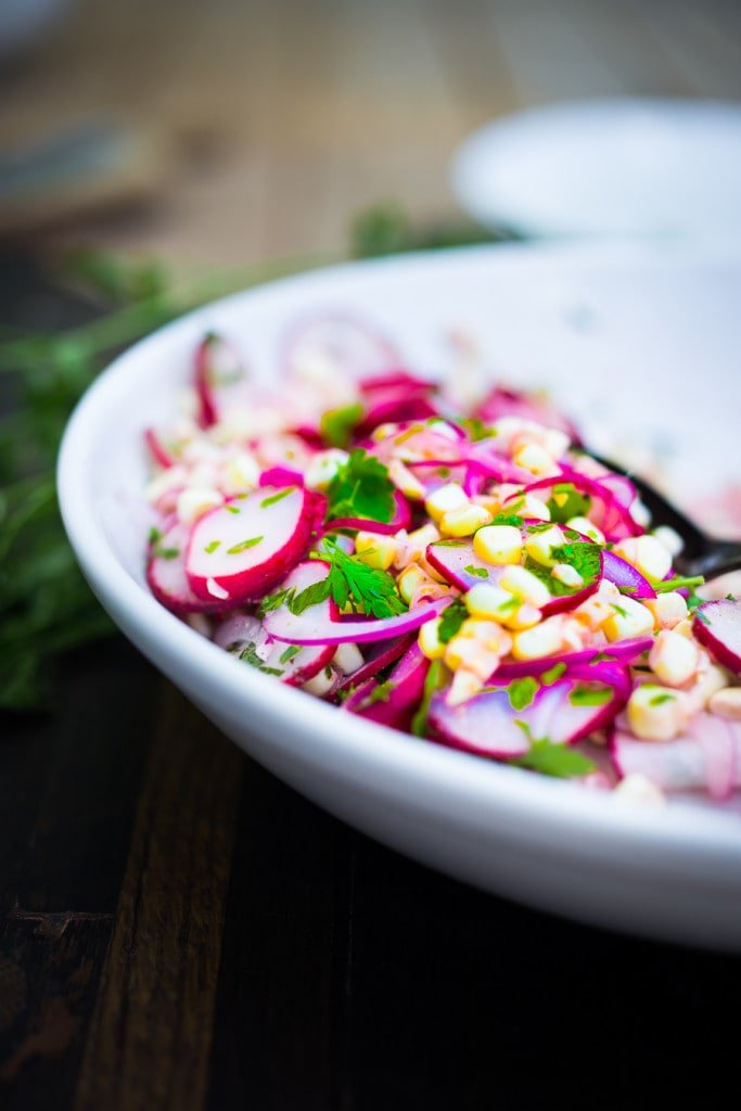 Grilled Flank Steak with Sweet Corn & Radish Salad...a healthy summer weeknight meal that can be made in 30 minutes!   www.feastingathome.com