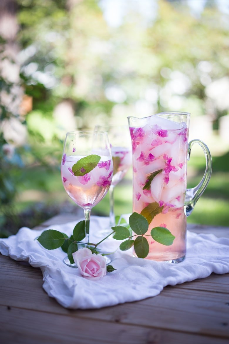 Rose Petal Sangria- made with wild rose petals and rosé wine – a refreshing summer drink that is lightly floral and delicious! Simple and Easy!