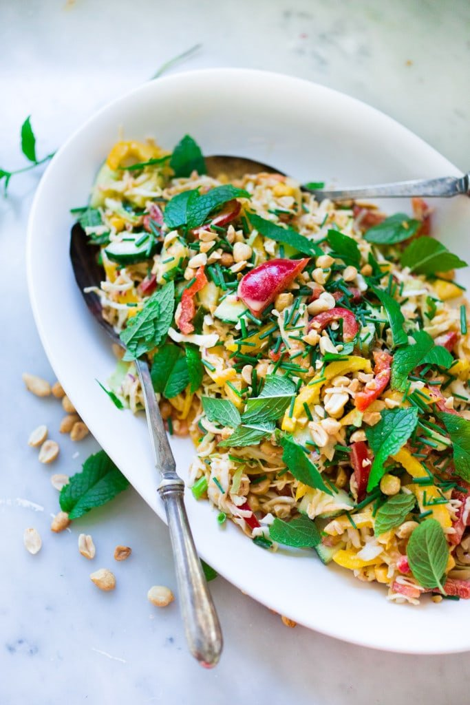 Thai Crunch Salad with mint, thai basil and scallions and a light peanut ginger dressing- vegan and gluten free| www.feastingathome.com