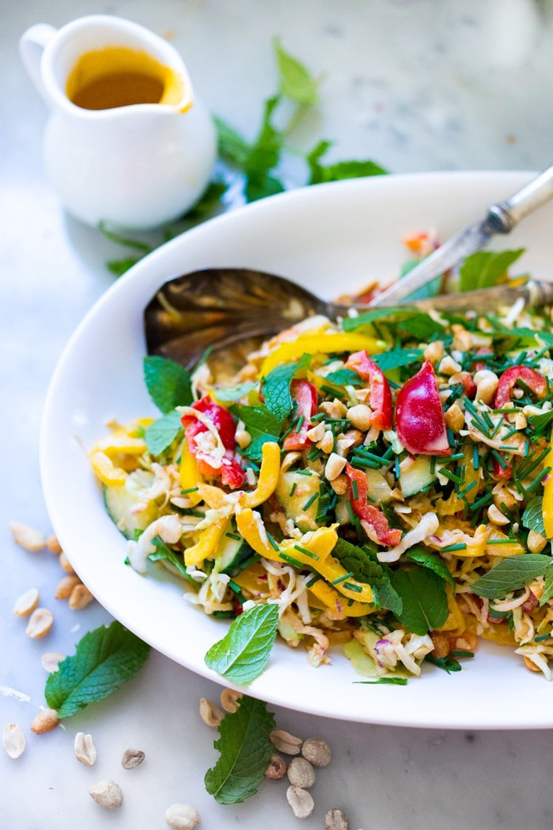 Thai Crunch Salad with a light peanut ginger dressing- vegan and gluten free| www.feastingathome.com
