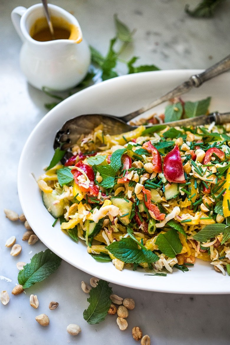 Thai Crunch Salad with Peanut Dressing is loaded up with healthy veggies, herbs and scallions. EASY, Vegan and gluten free! | www.feastingathome.com #glutenfree #vegan #thai #thaisalad #thaislaw #slaw
