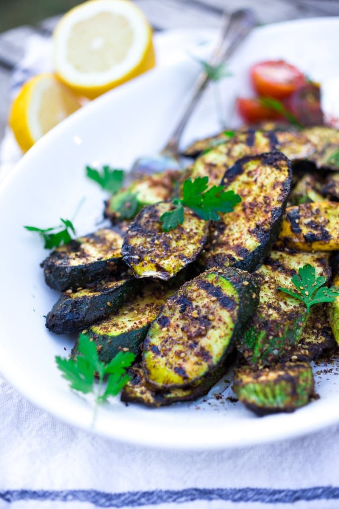 A simple recipe for Grilled Za'atar Zucchini with garlic, lemon, and a dollop of labneh or yogurt. Full of flavor, delicious and healthy!