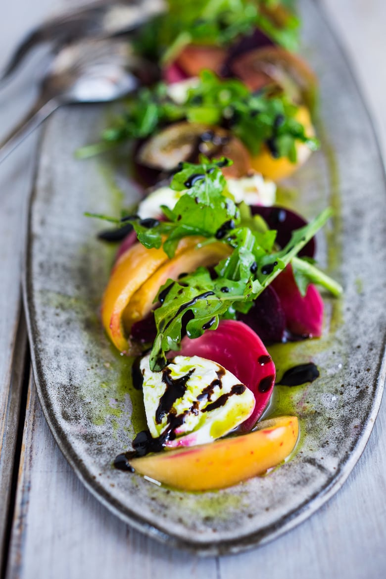 This Heirloom Tomato, Beet and Burrata Salad with flavorful Basil Oil is not only beautiful, but it is also delicious! Perfect for special gatherings... elegant, healthy and oh soooooooo tasty!