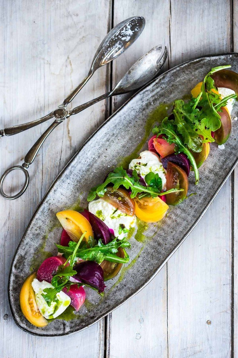 This Heirloom Tomato, Beet and Burrata Salad with flavorful Basil Oil is not only beautiful, but it is also delicious! Perfect for special gatherings... elegant, healthy and oh soooooooo tasty!#burratasalad #burrata