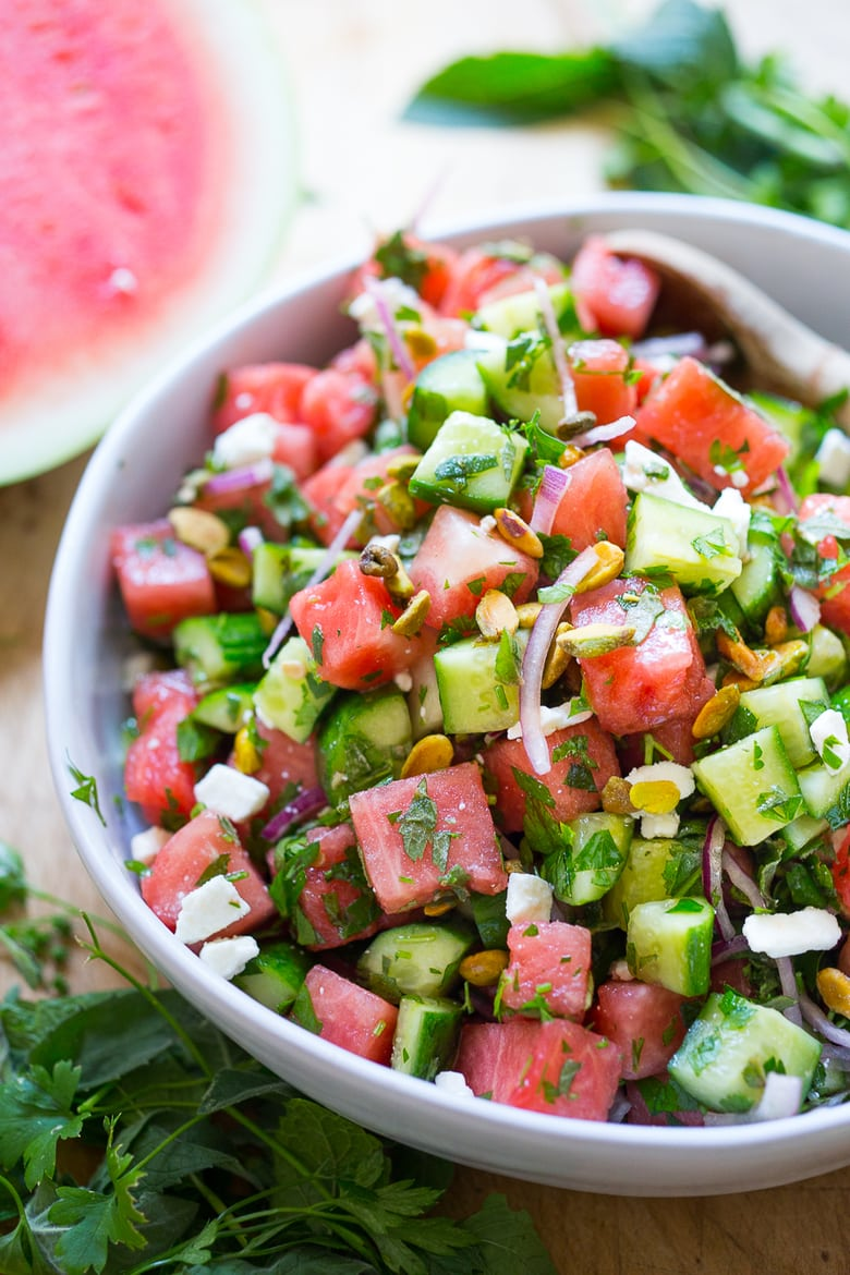 Moroccan Watermelon Salad with Cucumber, pistachios, parsley, mint, onion and crumbled feta...refreshing, simple and delicious! | www.feastingathome.com #watermelon #watermelonsalad #watermelonfetasalad #watermelonrecipes